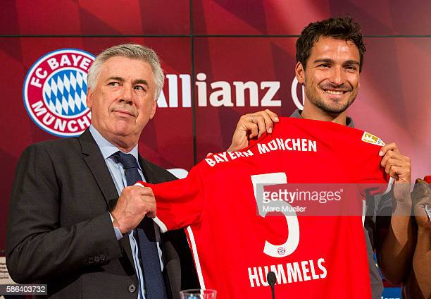 Carlo Ancelotti and Mats Hummels are seen during a press conference of FC Bayern Munich at Allianz Arena on August 6 2016 in Munich Germany