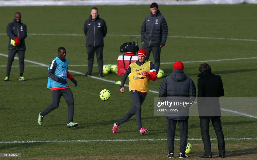 Carlo Ancelotti, coach of Paris Saint-Germain FC and Leonardo, Director of Football watch on as David Beckham of Paris Saint Germain FC is in action during a training session on February 13, 2013 in Paris, France.