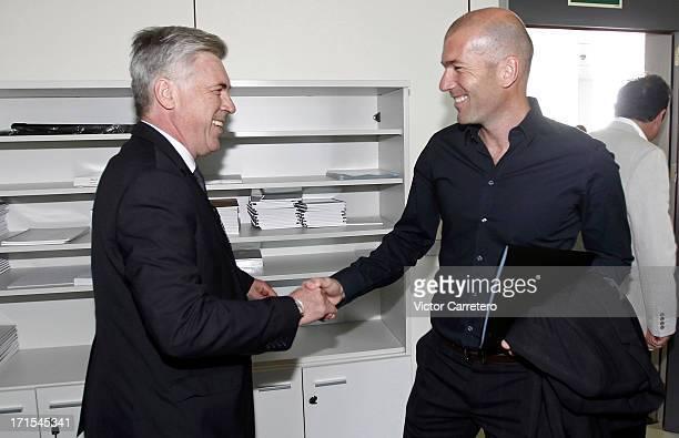 Carlo Ancelotti greets Zinedine Zidane at Ciudad Real Madrid on Valdebebas on June 26 2013 in Madrid Spain