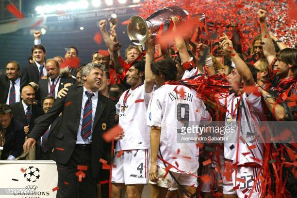 Carlo Ancelotti head coach of AC Milan with his players celebrate the victory with the trophy during the Final Champions League match between...