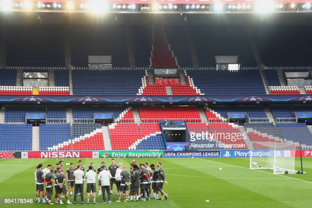 Carlo Ancelotti head coach of Bayern Muenchen talks to his playefrs prior to a training session ahead of the UEFA Champions League Group B match...