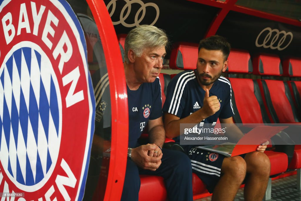Carlo Ancelotti, head coach of Bayern Muenchen tolks to his son and assistent coach Davide Ancelotti prior to the Audi Football Summit 2017 match between Bayern Muenchen and Arsenal FC at Shanghai Stadium during the Audi Summer Tour 2017 on July 19, 2017 in Shanghai, China.