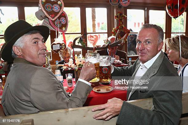 Carlo Ancelotti head coach of FC Bayern Muenchen and KarlHeinz Rummenigge CEO of FC Bayern Muenchen attend the Oktoberfest beer festival at Kaefer...