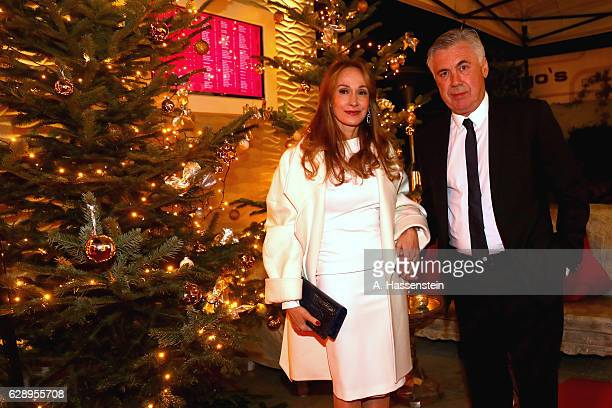 Carlo Ancelotti head coach of FC Bayern Muenchen attends with Mariann Barrena McClay the club's Christmas party at H'ugo's bar on December 10 2016 in...
