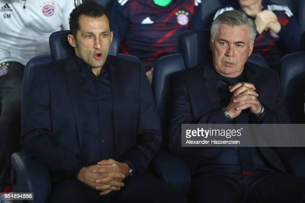 Carlo Ancelotti, head coach of FC Bayern Muenchen looks on with Hasan Salihamidzic , sporting director of Muenchen prior to the UEFA Champions League...