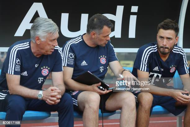 Carlo Ancelotti head coach of FC Bayern Muenchen talk to his assistent coaches Bixente Lizarazu and Davide Ancelotti prior to the International...