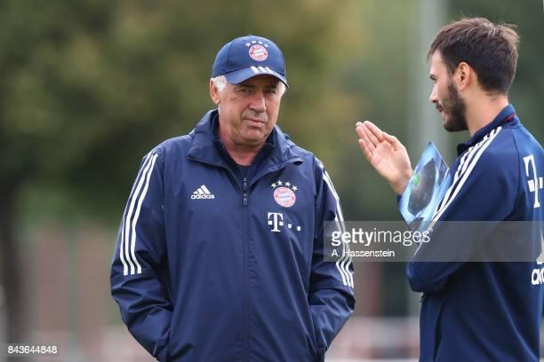 Carlo Ancelotti head coach of FC Bayern Muenchen talks to his assistent coach and son Davide Ancelotti during a FC Bayern Muenchen training session...