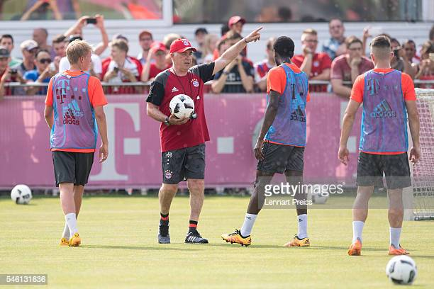 Carlo Ancelotti head coach of FC Bayern Munich talks to the players during a training session of FC Bayern Muenchen at Saebener Strasse training...