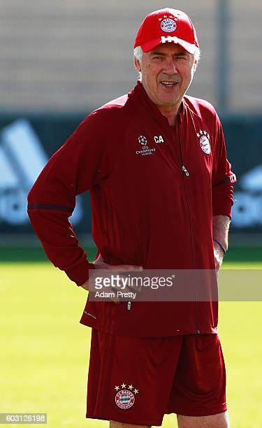 Carlo Ancelotti head coach of FC Bayern Munich watches the team train at FC Bayern Munich training grounds before their Champions League match...