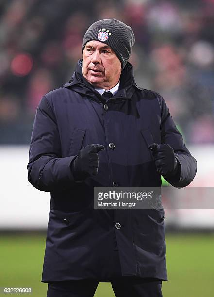 Carlo Ancelotti head coach of Muechen celebrates his teams win during the Bundesliga match between SC Freiburg and Bayern Muenchen at...