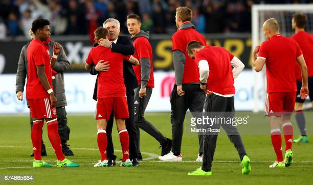 Carlo Ancelotti head coach of Muenchen celebrate with the team after the Bundesliga match between VfL Wolfsburg and Bayern Muenchen at Volkswagen...