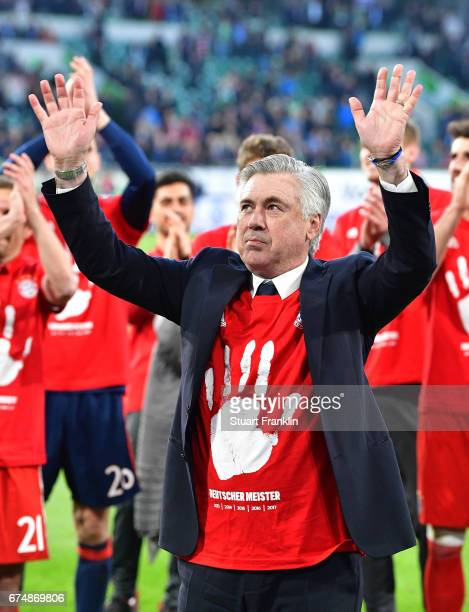 Carlo Ancelotti head coach of Muenchen celebrates winning the Bundesliga title after the Bundesliga match between VfL Wolfsburg and Bayern Muenchen...