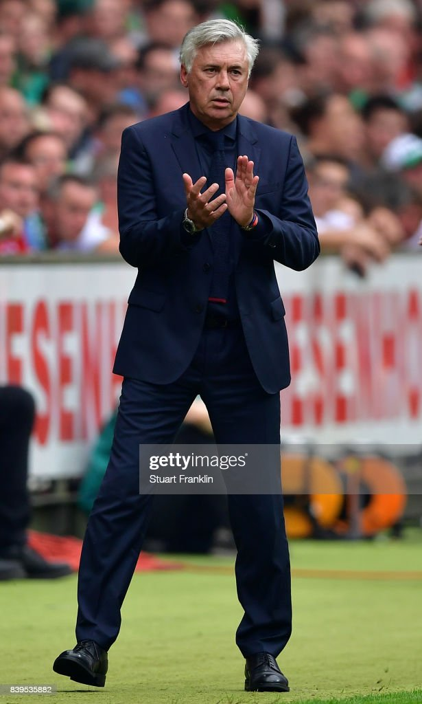 Carlo Ancelotti, head coach of Muenchen claps during the Bundesliga match between SV Werder Bremen and FC Bayern Muenchen at Weserstadion on August 26, 2017 in Bremen, Germany.
