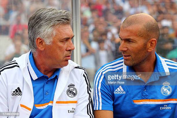 Carlo Ancelotti head coach of Real Madrid and assistant coach Zinedine Zidane look on before the pre season friendly match between Real Madrid and...