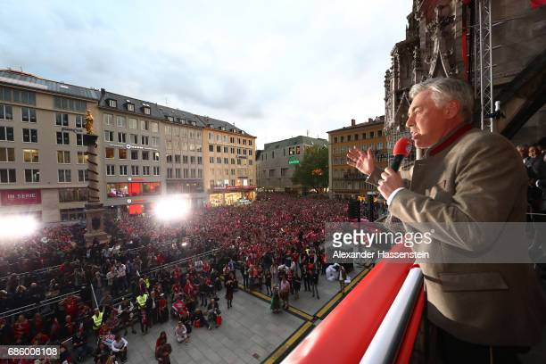 Carlo Ancelotti Manager of Bayern Muenchen speaks to the fans as they celebrate winning the 67th German Championship title on the town hall balcony...