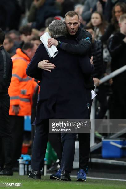 Carlo Ancelotti Manager of Everton and Duncan Ferguson assistant manager of Everton embrace each other following their victory in the Premier League...