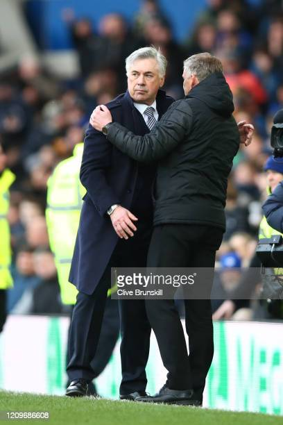 Carlo Ancelotti Manager of Everton and Ole Gunnar Solskjaer Manager of Manchester United shake hands after the Premier League match between Everton...