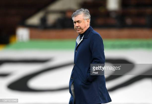 Carlo Ancelotti, Manager of Everton looks on as he makes his way across the pitch prior to kick off during the Premier League match between Fulham...