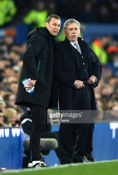 Carlo Ancelotti Manager of Everton speaks to his assistant manger Duncan Ferguson during the Premier League match between Everton FC and Newcastle...