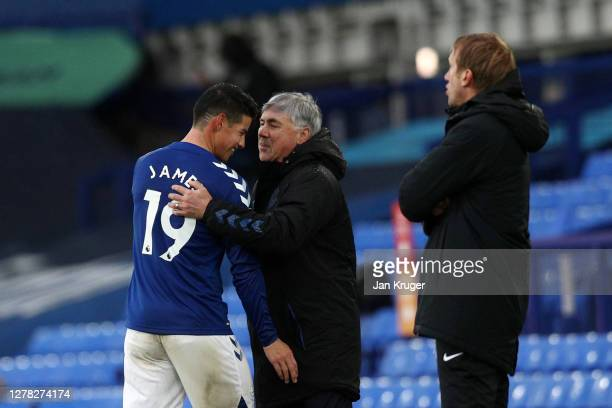 Carlo Ancelotti, Manager of Everton talks to James Rodriguez of Everton during the Premier League match between Everton and Brighton & Hove Albion at...