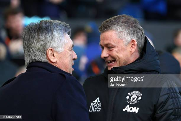 Carlo Ancelotti Manager of Everton welcomes Ole Gunnar Solskjaer Manager of Manchester United prior to the Premier League match between Everton FC...