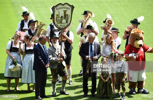 Carlo Ancelotti new head coach of German Bundesliga soccer club FCBayern Munich poses with a pair of leather trousers next to a brass band and next...