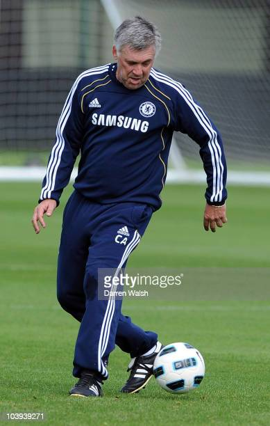 Carlo Ancelotti of Chelsea back heels the ball away from Alex during a training session at the Cobham training ground on September 9 2010 in Cobham...