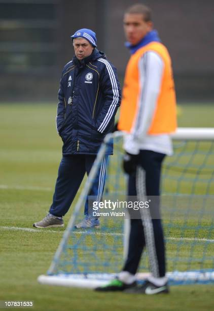 Carlo Ancelotti of Chelsea looks on at Jeffrey Bruma during a training session at the Cobham training ground on December 31, 2010 in Cobham, England.