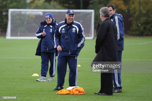 Carlo Ancelotti of Chelsea with Ex manager Guus Hiddink during a training session at the Cobham Training ground on October 28, 2010 in Cobham,...