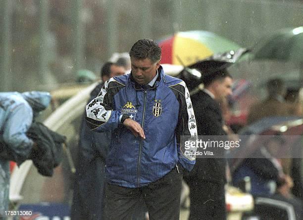 Carlo Ancelotti of FC Juventus looks at his watch during the Serie A 1999/ 2000 34th round match between Perugia and Juventus played at the Renato...
