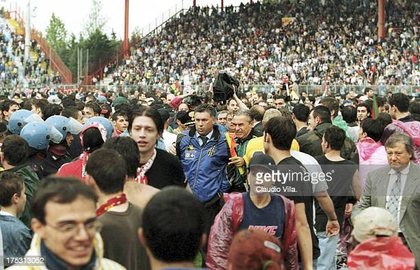 Carlo Ancelotti of FC Juventus tries to escape from supporters after the end of the game the Serie A 1999/ 2000 34th round match between Perugia and...
