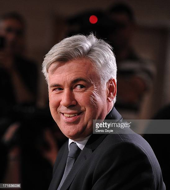 Carlo Ancelotti smiles as he attends a press conference where he was presented as the new head coach of Real Madrid at Estadio Bernabeu on June 26...