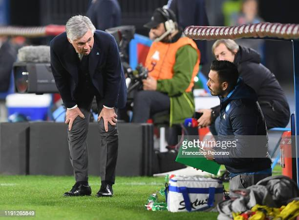 Carlo Ancelotti SSC Napoli coach and his assistant Davide Ancelotti during the Serie A match between SSC Napoli and Bologna FC at Stadio San Paolo on...