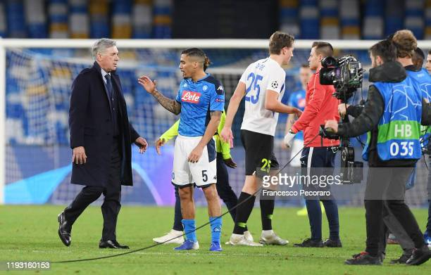 Carlo Ancelotti SSC Napoli coach greets Allan of SSC Napoli after the UEFA Champions League group E match between SSC Napoli and KRC Genk at Stadio...