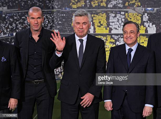 Carlo Ancelotti stands alongside former player Zinedine Zidane and club president Florentino Perez while being presented as the new head coach of...