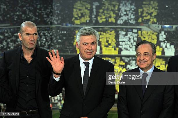 Carlo Ancelotti stands beside former Real Madrid player Zinedine Zidane and Real president Florentino Perez while being presented as Real's new head...