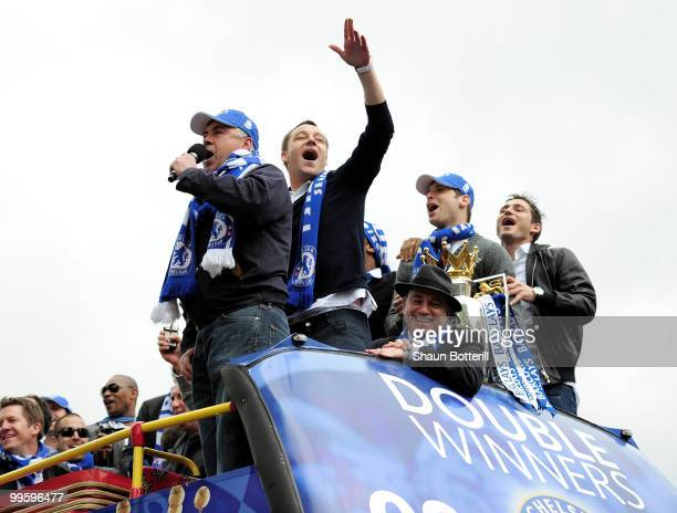 Carlo Ancelotti the Chelsea coach and captain John Terry sing to the crowd during the Chelsea FC Victory Parade on May 16 2010 in London England