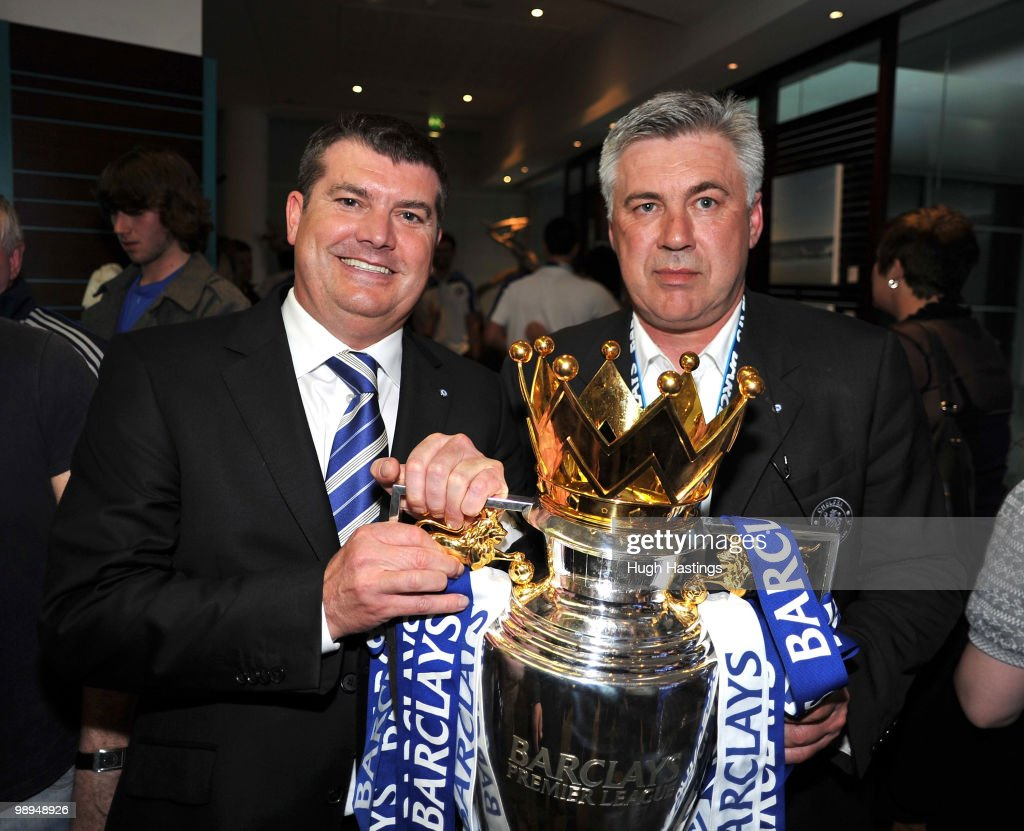 Carlo Ancelotti, the Chelsea manager, and Chief Executive Ron Gourlay pose with the trophy after winning the league with an 8-0 victory, following the Barclays Premier League match between Chelsea and Wigan Athletic at Stamford Bridge on May 9, 2010 in London, England.