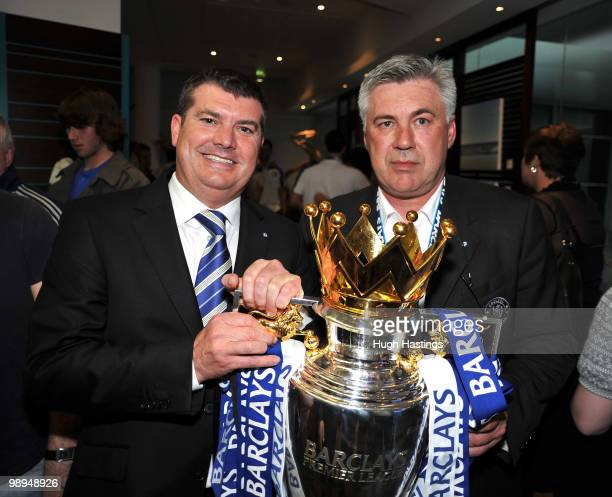 Carlo Ancelotti the Chelsea manager and Chief Executive Ron Gourlay pose with the trophy after winning the league with an 80 victory following the...