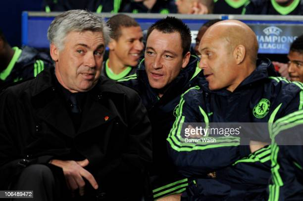 Carlo Ancelotti the Chelsea manager John Terry of Chelsea and Ray Wilkins the Chelsea assistant manager chat prior to kickoff during the UEFA...