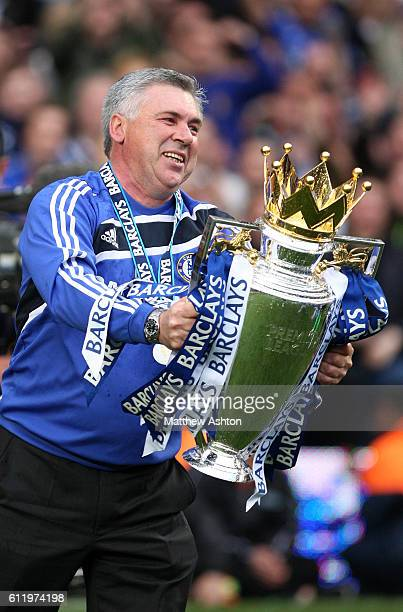 Carlo Ancelotti the head coach / manager of Chelsea celebrates with the Premier League Trophy