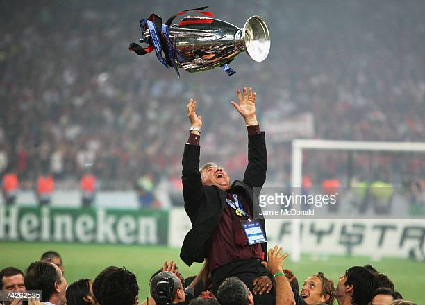 Carlo Ancelotti, the Milan manager throws the trophy in the air, whilst celebrating his teams 2-1 victoryduring the UEFA Champions League Final match...
