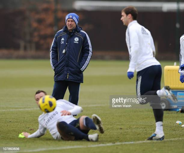 Carlo Ancelotti watches John Terry Branislav Ivanovic of Chelsea during a training session at the Cobham training ground on January 4 2011 in Cobham...