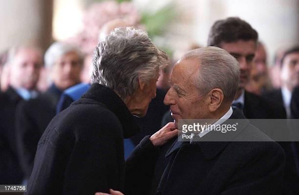 Carlo Azeglio Ciampi the Italian President of the Italian Republic kisses Marella Agnelli the wife of Fiat honorary chairman Giovanni Agnelli inside...