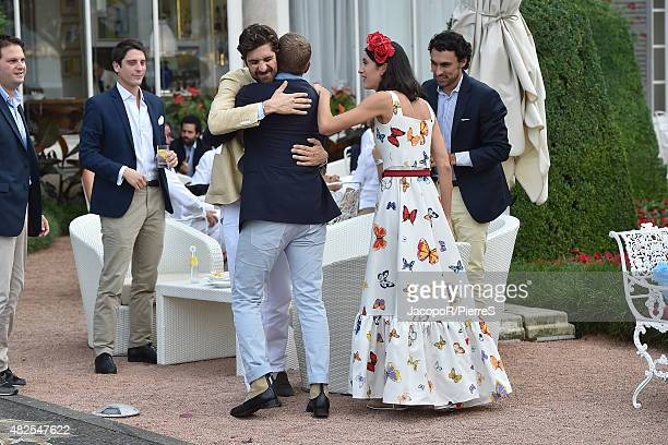 Carlo Borromeo Lapo Elkann and Marta Ferri are seen on July 31 2015 in Stresa Italy