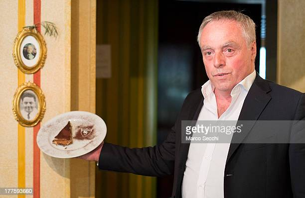Carlo Campeol the present owner of Restaurant 'Alle Beccherie' and son of Alba poses with a slice of Tiramisu on August 24 2013 in Treviso Italy...
