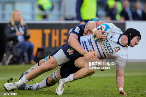 Carlo Canna of Italy is tackled by Scott Cummings of Scotland during the 2020 Guinness Six Nations match between Italy and Scotland at Stadio...