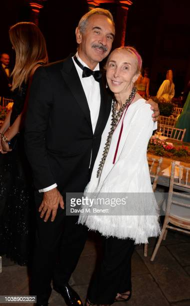 Carlo Capasa and Carla Sozzani attend The Green Carpet Fashion Awards Italia 2018 after party at Gallerie d'Italia on September 23 2018 in Milan Italy