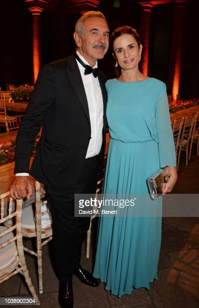 Carlo Capasa and Livia Firth attend The Green Carpet Fashion Awards Italia 2018 after party at Gallerie d'Italia on September 23 2018 in Milan Italy