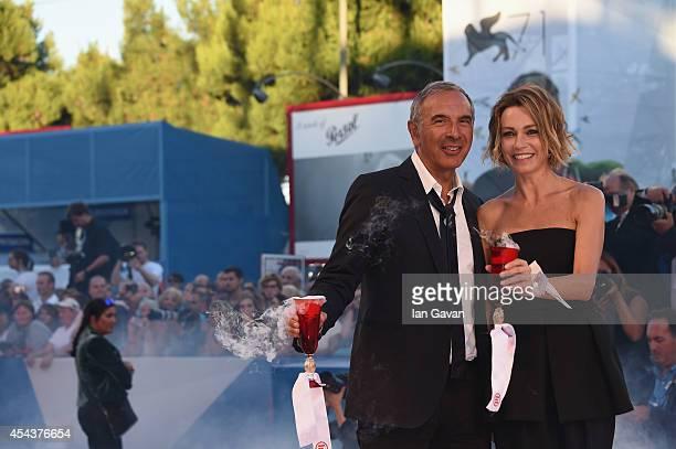 Carlo Capasa and Stefania Rocca attend the 'La Rancon de la gloire' Premiere during the 71st Venice Film Festival at the Palazzo del Cinema on August...